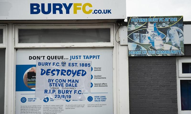 Fans' anger is expressed on a poster outside Gigg Lane.