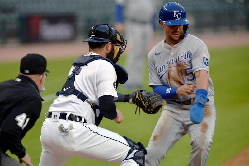 Detroit Tigers catcher Austin Romine tags out Kansas City Royals' Whit Merrifield during the first inning of a baseball game Tuesday, Sept. 15, 2020, in Detroit.