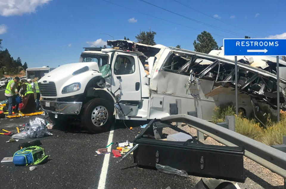 FILE - This Friday, Sept. 20, 2019, file photo released by the Garfield County Sheriff's Office shows a tour bus that was carrying Chinese-speaking tourists after it crashed near Bryce Canyon National Park in southern Utah, killing at least four people and critically injuring up to 15 others. The families of Chinese tourists killed or injured in a 2019 tour bus crash say the state's design and maintenance failed to keep the remote highway safe. More than a dozen people were thrown from the bus when the driver drifted off the road and overcorrected when he steered back, sending the bus into a rollover. A lawsuit alleges the state failed to post warning signs, had a road design that left little room for error and included no rumble strip to warn drivers. The NTSB investigation found a lack of safety standards for bus roofs and windows contributed to death and injury toll. Its final report, released in June, also cited inconsistent seat belt use and recommended a lane-departure warning system for commercial buses. (Sheriff Danny Perkins/Garfield County Sheriff's Office via AP, File)