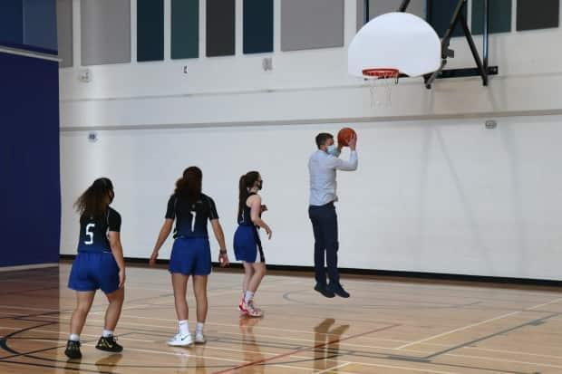 Premier Iain Rankin took to the basketball court following Saturday's announcement.