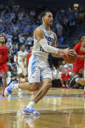 Rhode Island's Tyrese Martin (4) during the second half of an NCAA college basketball game against Dayton Wednesday, March 4, 2020, in Kingston, R.I. (AP Photo/Stew Milne)