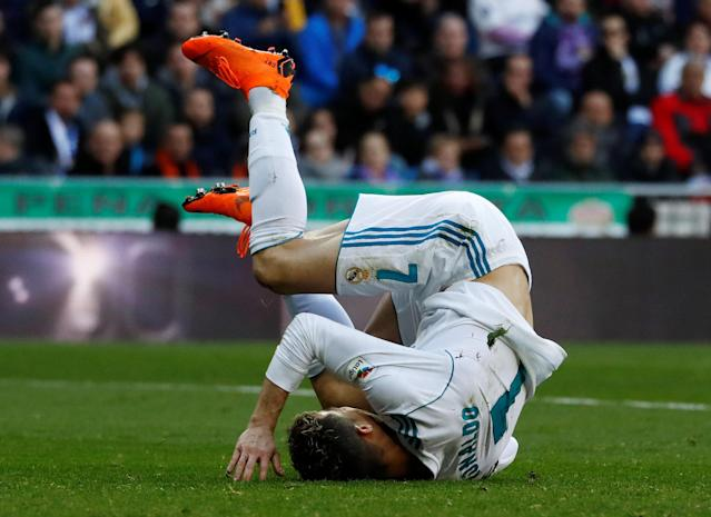 Soccer Football - La Liga Santander - Real Madrid vs Deportivo Alaves - Santiago Bernabeu, Madrid, Spain - February 24, 2018 Real Madrid's Cristiano Ronaldo tumbles after a challenge REUTERS/Juan Medina