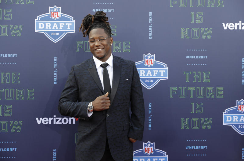 Central Florida's Shaquem Griffin poses for photos on the red carpet before the NFL draft. (AP)