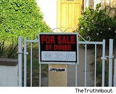 For Sale by Owner sign hanging on a fence.