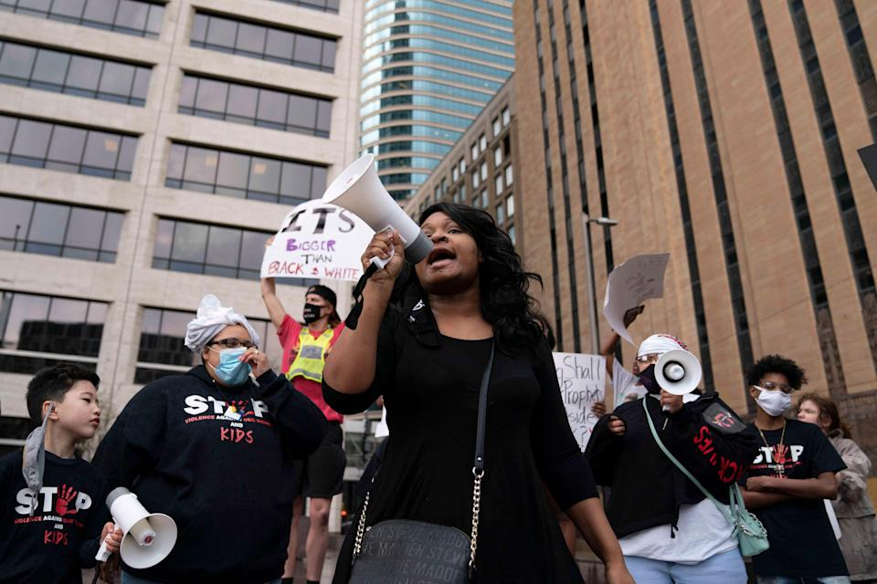 Toshira Garraway leads chants during a protest in front of the Minneapolis Government Center in Minneapolis on April 6. Garraway founded the organization Families Supporting Families Against Police Violence after her fiance, Justin Teigen, was found dead at a recycling facility after he was pulled over by St. Paul police.