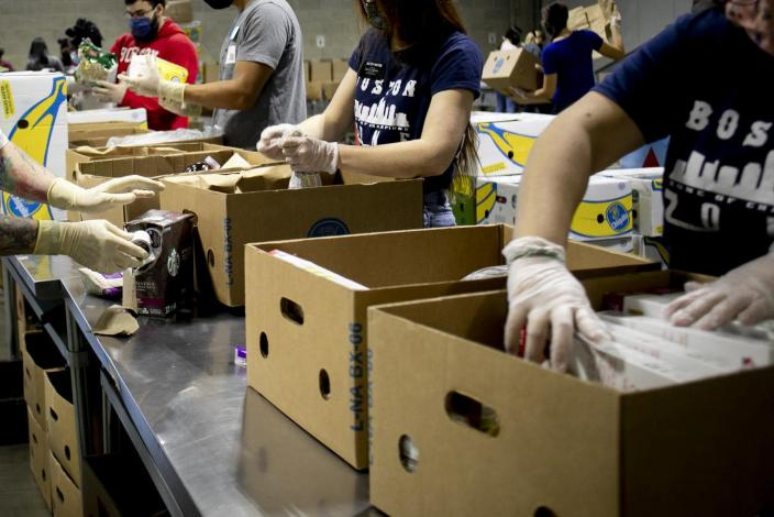 "<span class=""caption"">Volunteers prepare boxes at the Greater Boston Food Bank on Oct. 1, 2020.</span> <span class=""attribution""><a class=""link rapid-noclick-resp"" href=""https://www.gettyimages.com/detail/news-photo/volunteers-quality-check-and-prepare-boxes-to-load-for-news-photo/1229827185?adppopup=true"" rel=""nofollow noopener"" target=""_blank"" data-ylk=""slk:Iaritza Menjivar, The Washington Post via Getty Images"">Iaritza Menjivar, The Washington Post via Getty Images</a></span>"