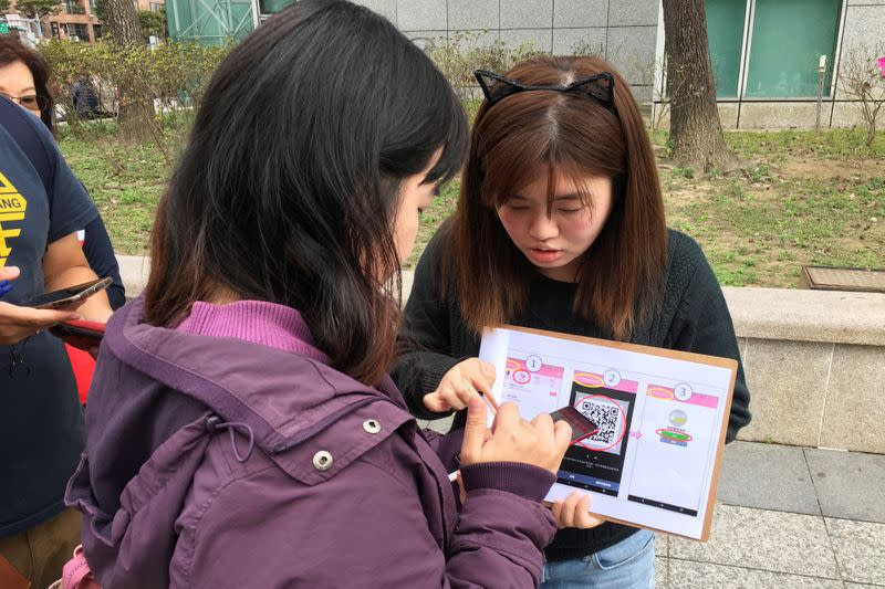 People attend an event organised by Taiwanese NGO Fake News Cleaner on how to spot and report suspected fake news, in New Taipei City