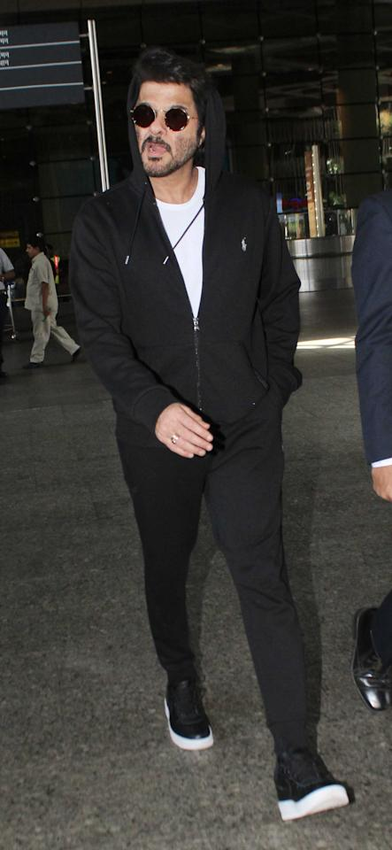 <p>The ageless star looks as young as his son, Harshvardhan, in this black and white sporty outfit. </p>