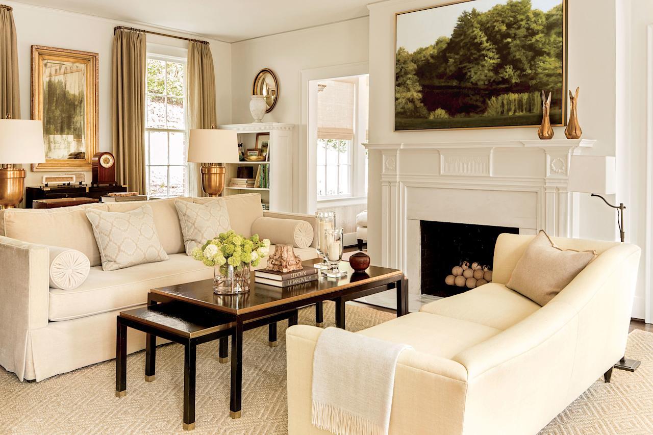 "<p>Benjamin Moore <a href=""https://www.benjaminmoore.com/en-us/color-overview/find-your-color/color/925/ivory-white?color=925"">Acadia White (OC-38)</a> (also known as Ivory White) has been around for quite a while, and we don't forsee it going anywhere any time soon. In this <a href=""https://www.southernliving.com/home-garden/decorating/lindsay-bierman-home-tour#lindsay-bierman-living-room-neutral"">living room</a>, Lindsay Bierman doubled down on the formula for a warmer ivory hue.</p>"