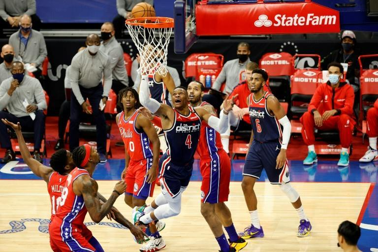 Washington's Russell Westbrook elevates for a lay-up in the Wizards' NBA season-opening loss to the Philadelphia 76ers
