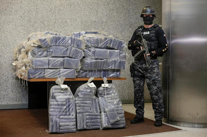 <p>A Romanian special forces unit member stands guard near bags containing part of 2.5 tonnes of cocaine seized in the Black Sea port of Constanta, Romania, July 1, 2016. (Photo: Inquam Photos/Octav Ganea/via REUTERS) </p>