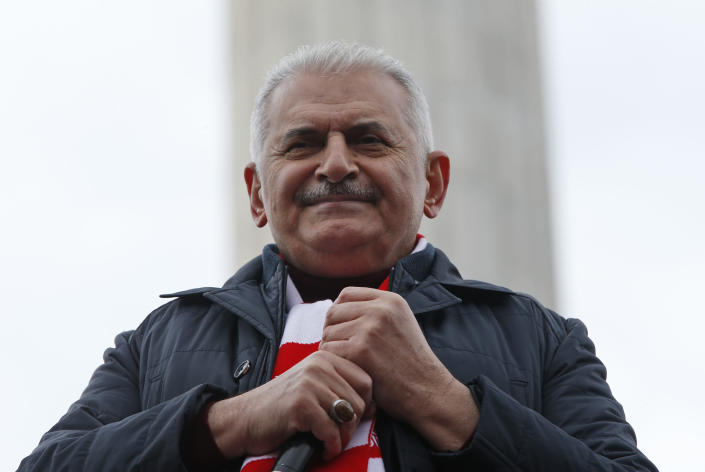 Binali Yildirim, the mayoral candidate for Istanbul, talks to supporters at a rally of his ruling Justice and Development Party's (AKP), in Istanbul, Friday, March 29, 2019, ahead of local elections scheduled for March 31, 2019. (AP Photo/Lefteris Pitarakis)