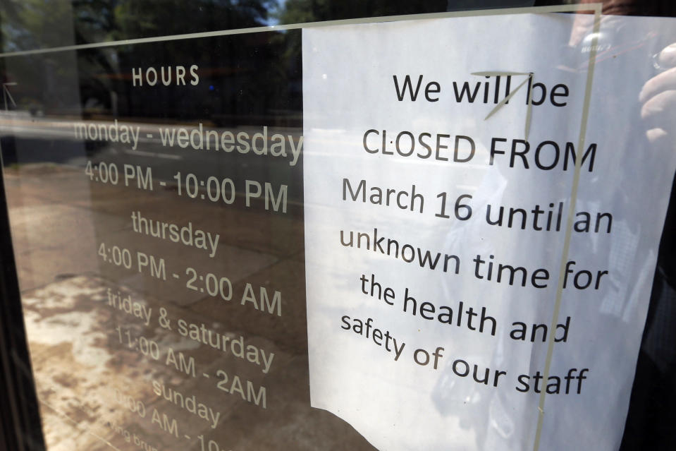 FILE- In this May 7, 2020, file photo, a closed sign posted on the front door of the closed Tarrant's Café restaurant in Richmond, Va. Enacting restrictions to prevent the spread of the coronavirus is more important than removing them to get the economy going, according to a majority of Virginia voters polled this month. A poll conducted by Hampton University and The Associated Press-NORC Center for Public Affairs Research found that 62% think the biggest priority for their community is to prevent the coronavirus from spreading, even if it hurts the economy, while 35% said removing restrictions to help the economy, even if more people get the virus, is the bigger priority. (AP Photo/Steve Helber, File)