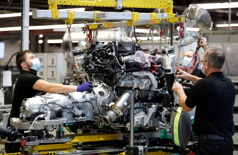 FILE PHOTO: Technicians work on a Rolls-Royce engine prior to it being installed in a car on the production line of the Rolls-Royce Goodwood factory, near Chichester