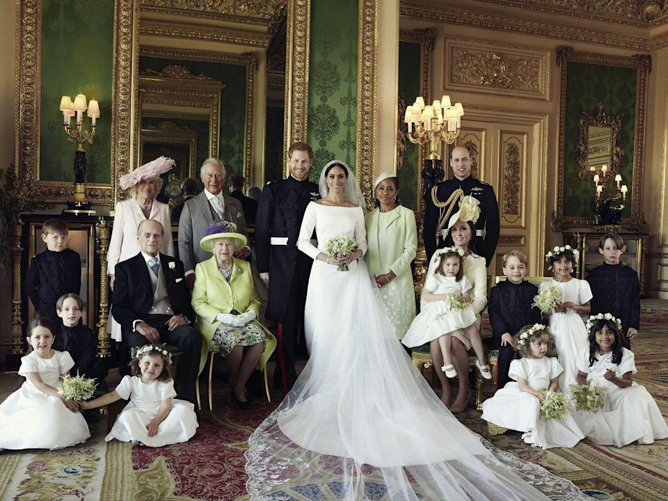 """<p>2018 has been a big year for the British royals. In April, <a href=""""https://www.townandcountrymag.com/society/tradition/a19135202/prince-louis-first-official-portrait-kate-middleton/"""" rel=""""nofollow noopener"""" target=""""_blank"""" data-ylk=""""slk:the Duke and Duchess of Cambridge welcomed Prince Louis"""" class=""""link rapid-noclick-resp"""">the Duke and Duchess of Cambridge welcomed Prince Louis</a> and the following month, <a href=""""https://www.townandcountrymag.com/society/tradition/g14522381/prince-harry-meghan-markle-royal-wedding-2018-photos/"""" rel=""""nofollow noopener"""" target=""""_blank"""" data-ylk=""""slk:Prince Harry and Meghan Markle married"""" class=""""link rapid-noclick-resp"""">Prince Harry and Meghan Markle married</a> in a grand royal wedding. The newly-minted Duke and Duchess of Sussex posed <a href=""""https://www.townandcountrymag.com/society/tradition/a20873388/who-is-in-official-bridesmaid-page-boy-royal-wedding-portraits-2018/"""" rel=""""nofollow noopener"""" target=""""_blank"""" data-ylk=""""slk:for their official wedding portrait"""" class=""""link rapid-noclick-resp"""">for their official wedding portrait </a>with numerous other royals, including the Queen and Prince Philip, and <a href=""""https://www.townandcountrymag.com/society/tradition/a16405569/meghan-markle-mother-doria-ragland/"""" rel=""""nofollow noopener"""" target=""""_blank"""" data-ylk=""""slk:Meghan's mother, Doria Ragland"""" class=""""link rapid-noclick-resp"""">Meghan's mother, Doria Ragland</a>. Prince George and Princess Charlotte joined in as a page boy and bridesmaid.</p>"""