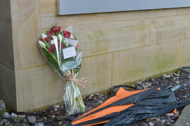 Flowers laid at the scene where Robert Wilson, 53 (named locally) was reportedly stabbed to death after confronting a group of youths near Huddersfield, West Yorks., January 18 2020. See SWNS story SWLEmurder:
