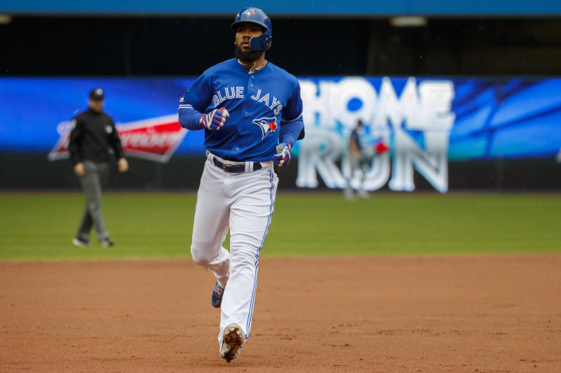 TORONTO, ON - SEPTEMBER 28: Teoscar Hernandez #37 of the Toronto Blue Jays rounds third base as he hits a solo home run during first inning of their MLB game against the Tampa Bay Rays Rogers Centre on September 28, 2019 in Toronto, Canada. (Photo by Cole Burston/Getty Images)