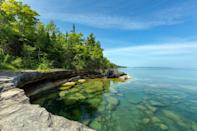 """<p>As its name would imply, <a href=""""https://www.michigan.org/great-lakes/lake-superior"""" rel=""""nofollow noopener"""" target=""""_blank"""" data-ylk=""""slk:Lake Superior"""" class=""""link rapid-noclick-resp"""">Lake Superior</a> one of the largest freshwater lakes in the world and part of the Great Lakes region. The water's surface covers 31,700 square miles and its cold waters reach a depth of 1,332 feet. Historically, its strong winds have even known to sink ships. The shoreline is dotted with lighthouses including the lake's oldest operating lighthouse, Whitefish Point Light Station.</p>"""