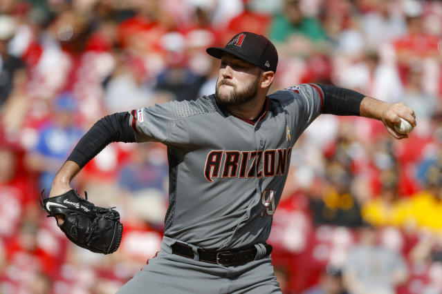 Arizona Diamondbacks starting pitcher Alex Young throws in the first inning of a baseball game against the Cincinnati Reds, Saturday, Sept. 7, 2019, in Cincinnati. (AP Photo/John Minchillo)