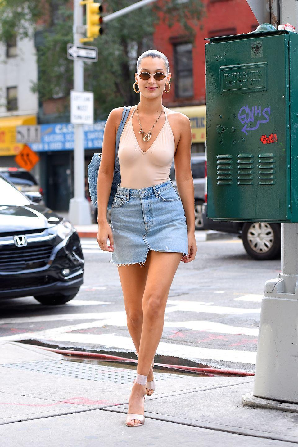<p>Bella Hadid in a summery denim skirt and body con combo, August 2017</p>