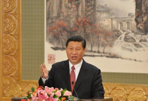 Chinese Vice President Xi Jinping speaks after being appointed head of the seven-member Communist Party of China Politburo Standing Committee, the nation's top decision-making body, at the Great Hall of the People in Beijing on November 15. China's all-powerful Communist Party unveiled a new leadership council steered by Xi to take command of the world's number two economy for the next decade