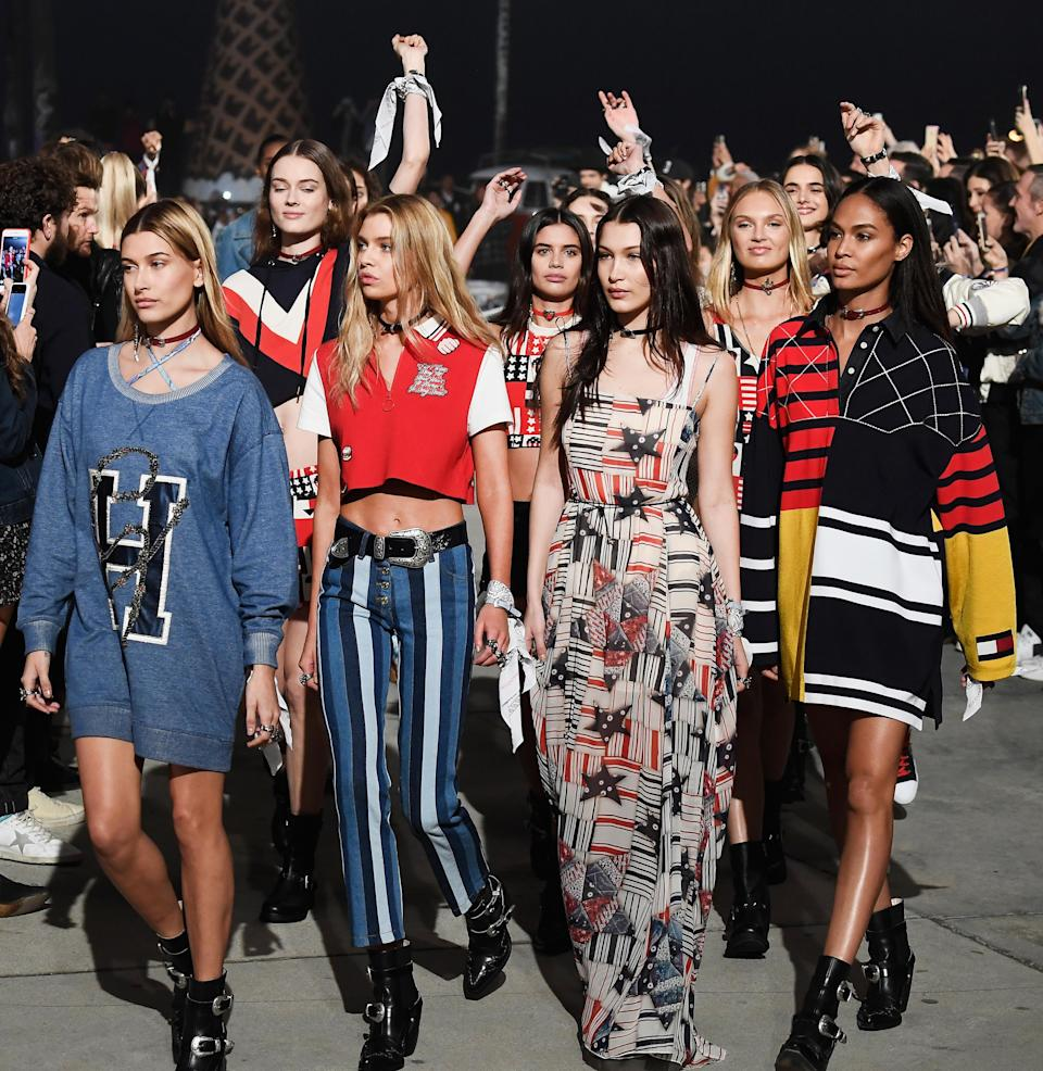 """<p>It's """"what I might wear for a day at the amusement park and the candy shop,"""" Gigi said backstage at the show. The modern day supermodel opened in leather trousers, crop top and cowboy boots. The star-spangled flag popped up on cardigans and boho dresses while more 90s sportswear also made an appearance.<br><i>[Photo: Getty]</i> </p>"""
