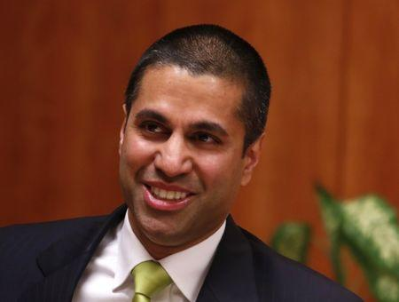 Ajit Pai arrives at a FCC Net Neutrality hearing