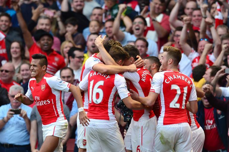 Arsenal's players celebrate after Aaron Ramsey scores his team's second and winning goal during their English Premier League match against Crystal Palace, at The Emirates Stadium in north London, on August 16, 2014