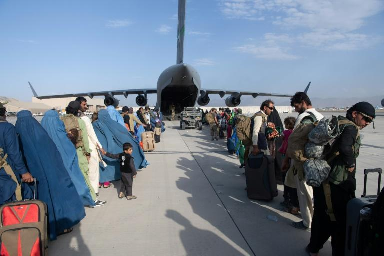Over 80,000 people have been evacuated since August 14, but huge crowds remain outside Kabul airport hoping to flee the threat of reprisals and repression in Taliban-led Afghanistan. (AFP/Donald R. ALLEN)
