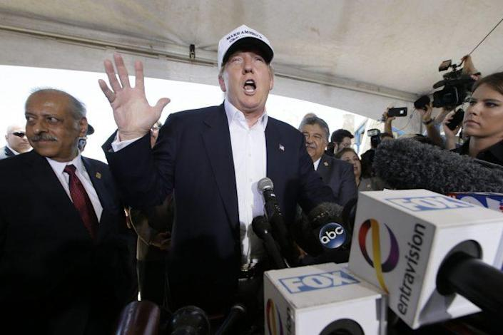 Republican presidential hopeful Donald Trump speaks to the media during a tour of the World Trade International Bridge at the U.S.-Mexico border in Laredo, Texas, July 23, 2015. (AP Photo/LM Otero)