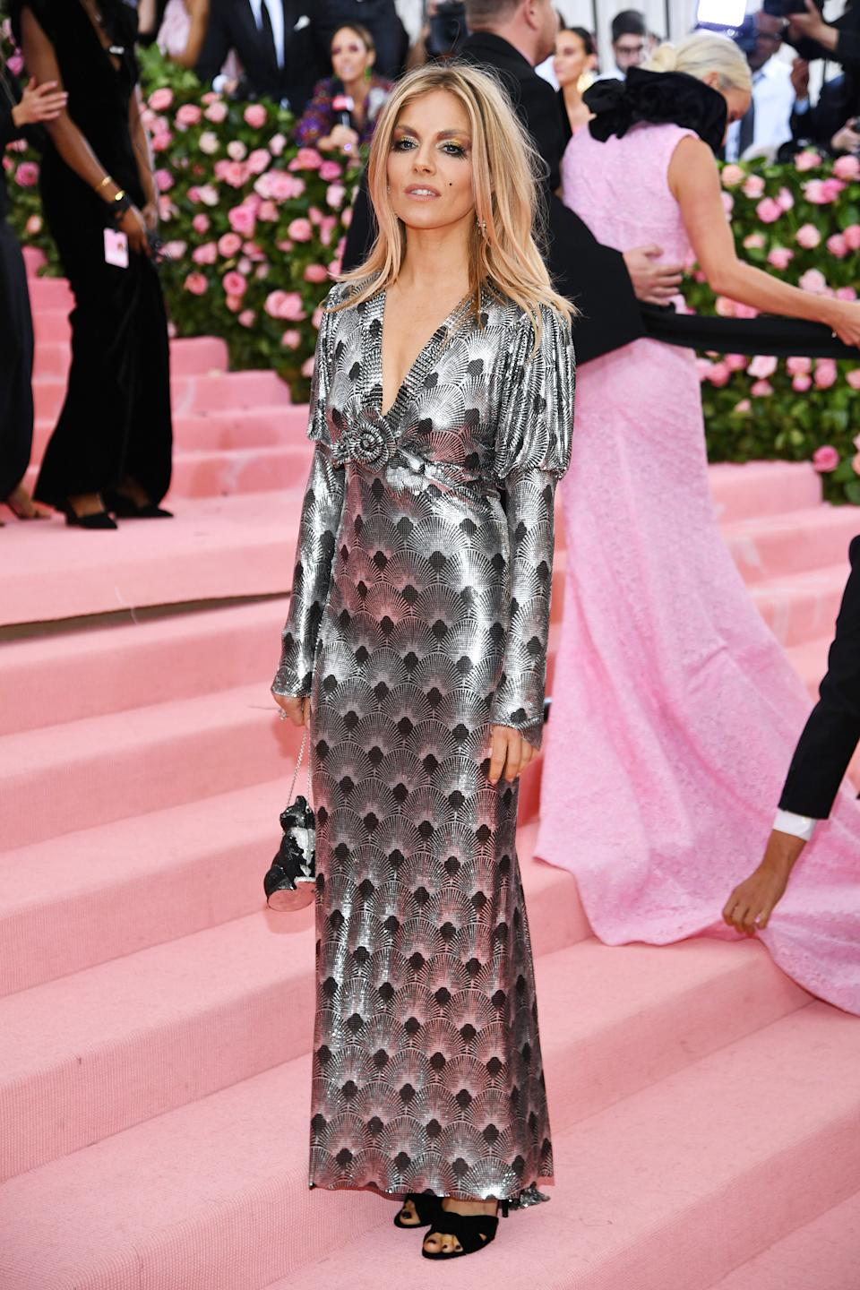 """<h1 class=""""title"""">Sienna Miller in Paco Rabanne with a Judith Leiber Couture bag</h1><cite class=""""credit"""">Photo: Getty Images</cite>"""