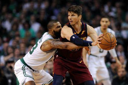 May 15, 2018; Boston, MA, USA; Boston Celtics forward Marcus Morris (13) defends Cleveland Cavaliers guard Kyle Korver (26) during the third quarter in game two of the Eastern conference finals of the 2018 NBA Playoffs at TD Garden. Mandatory Credit: Bob DeChiara-USA TODAY Sports