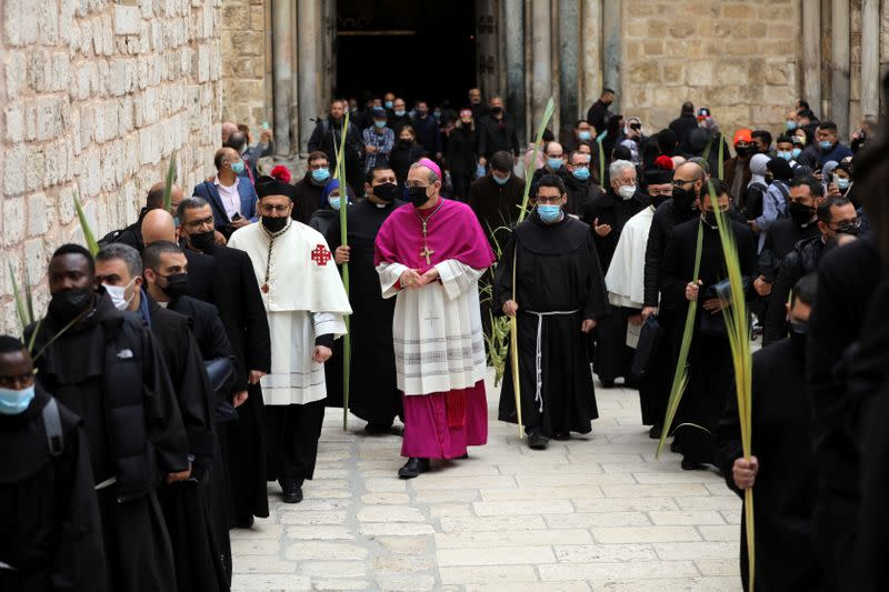 Palm Sunday marked in Jerusalem amid COVID-19 restrictions, for second year running