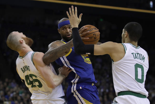Golden State Warriors' DeMarcus Cousins, center, fouls Boston Celtics' Aron Baynes, left, as he looks to pass the ball away from Jayson Tatum (0) during the first half of an NBA basketball game Tuesday, March 5, 2019, in Oakland, Calif. (AP Photo/Ben Margot)
