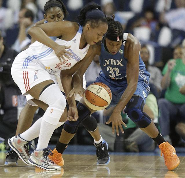 Atlanta Dream's Le'coe Willigham (43) works agains Minnesota Lynx' Rebekkah Brunson (32) during the first half of Game 3 of the WNBA Finals basketball game, in Duluth, Ga., Thursday, Oct. 10, 2013. (AP Photo/John Bazemore)