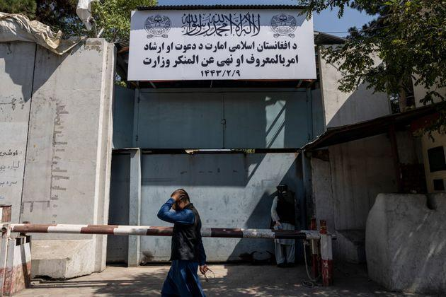 An Afghan man walks past the former Women's Affairs Ministry building in Kabul on Sept. 18. (Photo: via Associated Press)