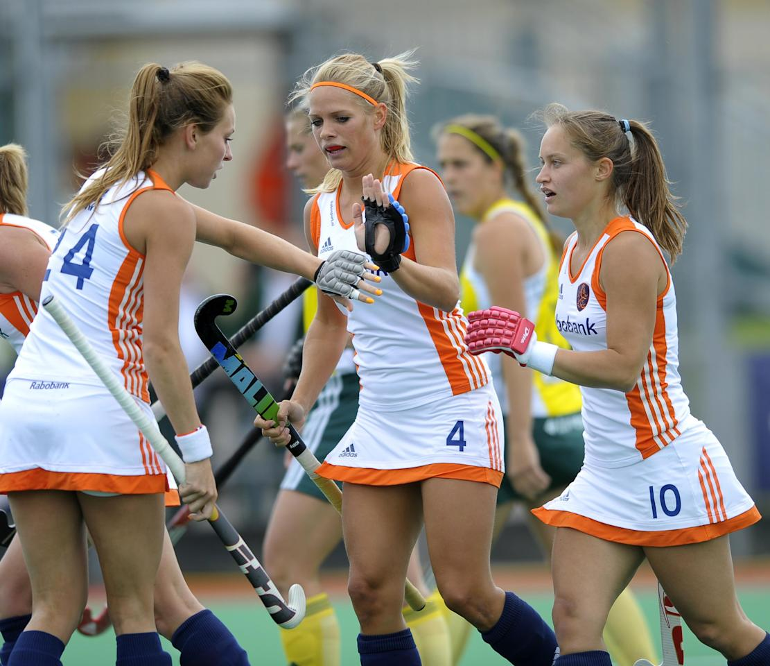 Netherland's Kelly Jonker celebrates scoring the opening goal, right, with Eva de Geode and Kitty van Male,center, in the first semi-final match of the Investec London Cup in Chiswick, London Saturday June 9, 2012.    (AP Photo/Ady Kerry/PA Wire)  UNITED KINGDOM OUT NO SALES NO ARCHIVE