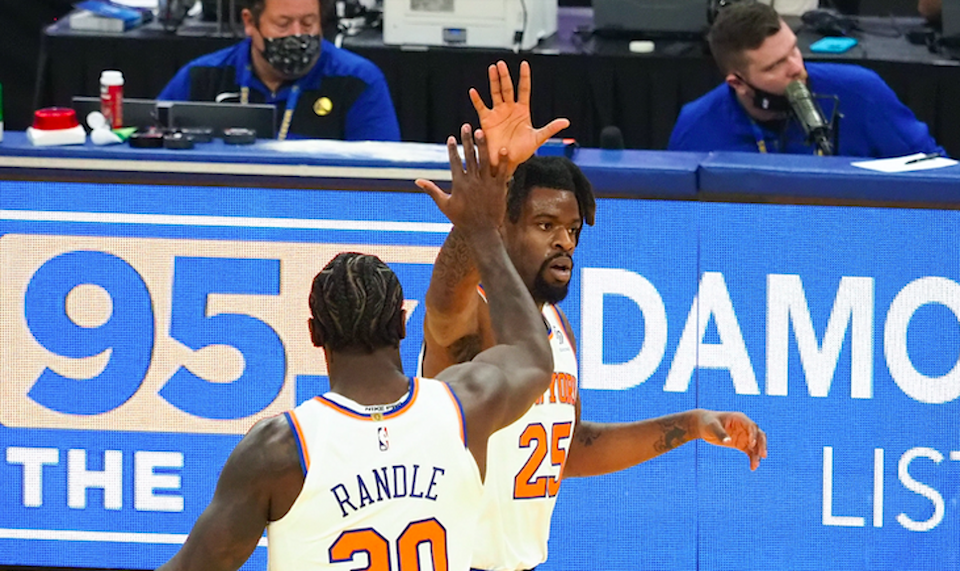 Jan 21, 2021; San Francisco, California, USA; New York Knicks forward Reggie Bullock (25) high fives forward Julius Randle (30) as a time out is called after scoring a basket against the Golden State Warriors during the first quarter at Chase Center. Mandatory Credit: Kelley L Cox-USA TODAY Sports
