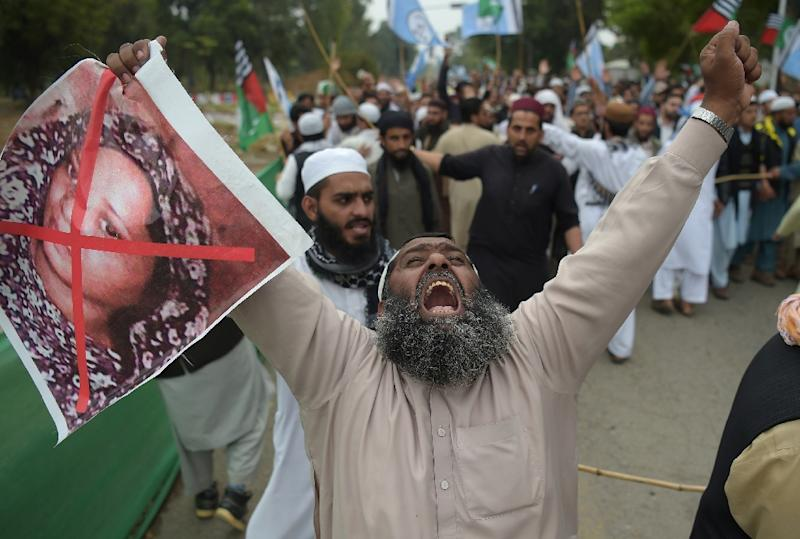 Activists have warned that Asia Bibi's life would be in danger if she stayed in Pakistan (AFP Photo/AAMIR QURESHI)