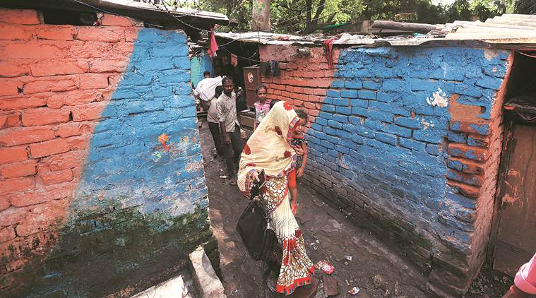 delhi slums, delhi slum families shifted, ews housing delhi, delhi city news