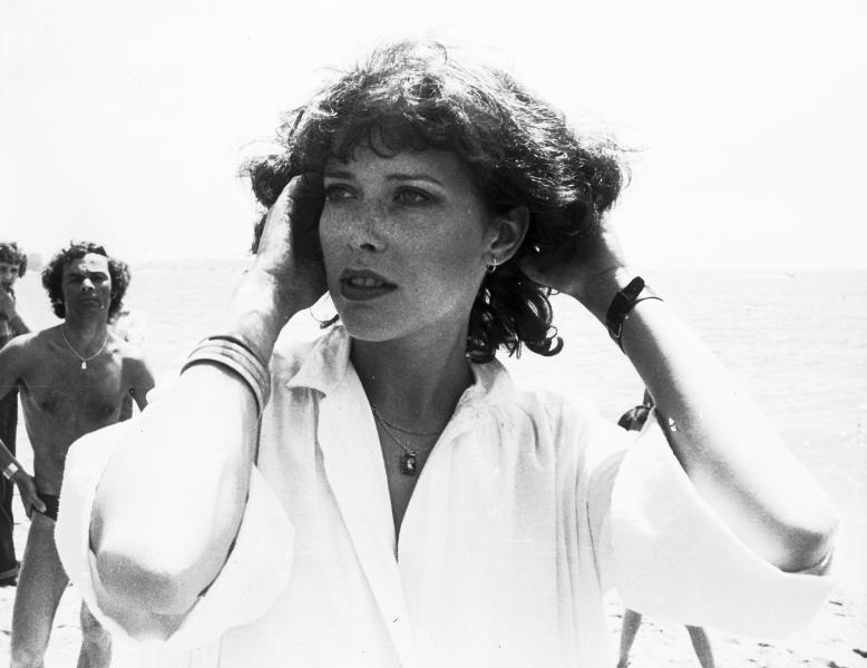 """FILE - In this May 22, 1975 file photo Dutch actress Sylvia Kristel, who played the role of """"Emmanuelle"""", poses for the camera on her arrival at the Cannes Film Festival in France. Sylvia Kristel has died of cancer at age 60. Her agent, Features Creative Management, said in a statement Thursday, Oct. 18, 2012, that Kristel died in her sleep Wednesday night. Kristel, a model who turned to acting in the 1970s, had been fighting cancer for several years. (AP Photo, File)"""