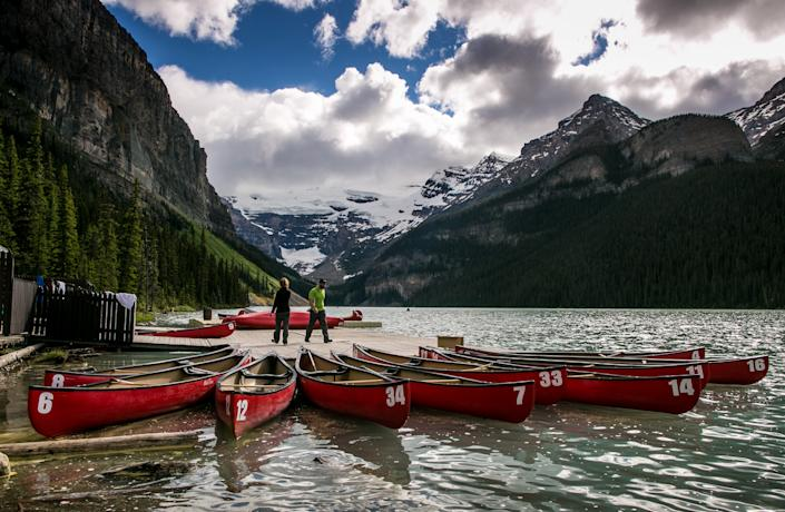 LAKE LOUISE, CANADA - JUNE 26: Canoes are rented at the Fairmont Chateau Lake Louise boathouse on June 26, 2013 in Lake Louise, Alberta, Canada. Major flooding along the Bow River in June washed out the Trans-Canada Highway 1 for nearly a week, forcing park visitors to cancel their vacation plans. (Photo by George Rose/Getty Images)