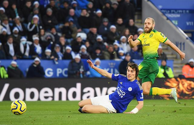 Teemu Pukki of Norwich City scores his team's first goal past Caglar Soyuncu of Leicester City. (Credit: Getty Images)
