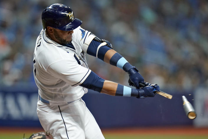 Tampa Bay Rays' Nelson Cruz breaks his bat as he grounds out against the Seattle Mariners during the fifth inning of a baseball game Tuesday, Aug. 3, 2021, in St. Petersburg, Fla. (AP Photo/Chris O'Meara)