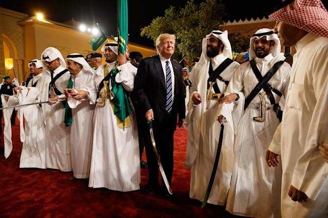 <p>President Donald Trump holds a sword and sways with traditional dancers during a welcome ceremony at Murabba Palace, Saturday, May 20, 2017, in Riyadh. (Photo: Evan Vucci/AP) </p>