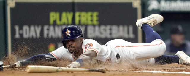 Houston Astros' Tony Kemp scores during the third inning of a baseball game against the Seattle Mariners Tuesday, Sept. 18, 2018, in Houston. (AP Photo/David J. Phillip)