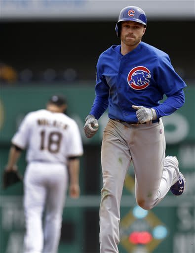 Chicago Cubs' Nate Schierholtz, right, rounds second past Pittsburgh Pirates second baseman Neil Walker (18) after hitting a 2-run home run during the ninth inning of a baseball game in Pittsburgh Thursday, April 4, 2013. The Cubs won 3-2. (AP Photo/Gene J. Puskar)