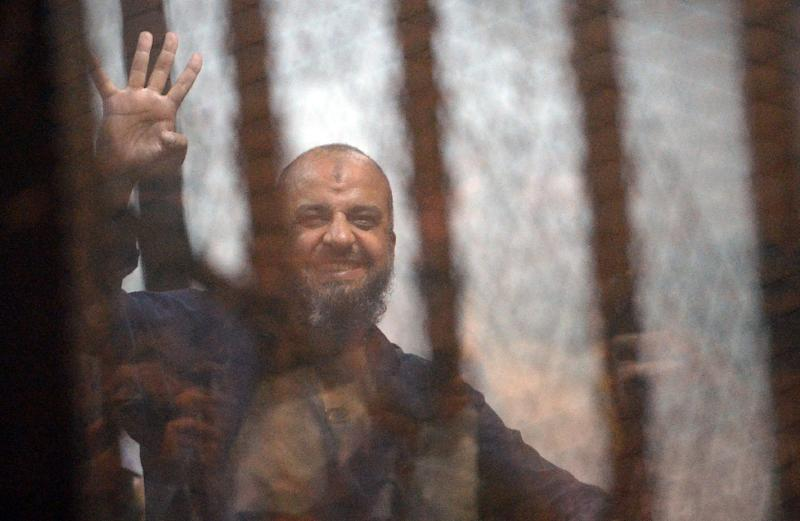Top Egyptian Muslim Brotherhood leader Mohamed Beltagy gestures from the defendents cage during his trial alongside 14 others, including former Islamist president Mohamed Morsi, at a court in the capital, Cairo, on April 21, 2015 (AFP Photo/Mohamed el-Shahed)