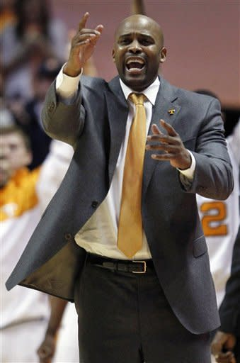 Tennessee head coach Cuonzo Martin yells to his team in the second half of an NCAA college basketball game against Kentucky on Saturday, Jan. 14, 2012, in Knoxville, Tenn. Kentucky won 65-62. (AP Photo/Wade Payne)