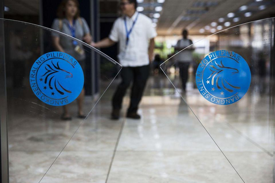 The Bangko Sentral ng Pilipinas logo is displayed on an automatic barrier at its headquarters in the Philippines. (Photo: Getty Images)